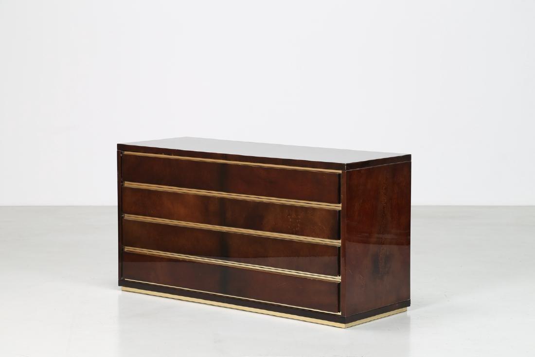 ALDO TURA Cassettiera in legno pergamena e ottone, anni