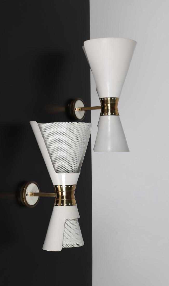 ANGELO LELLI Coppia di lampade da parete in metallo