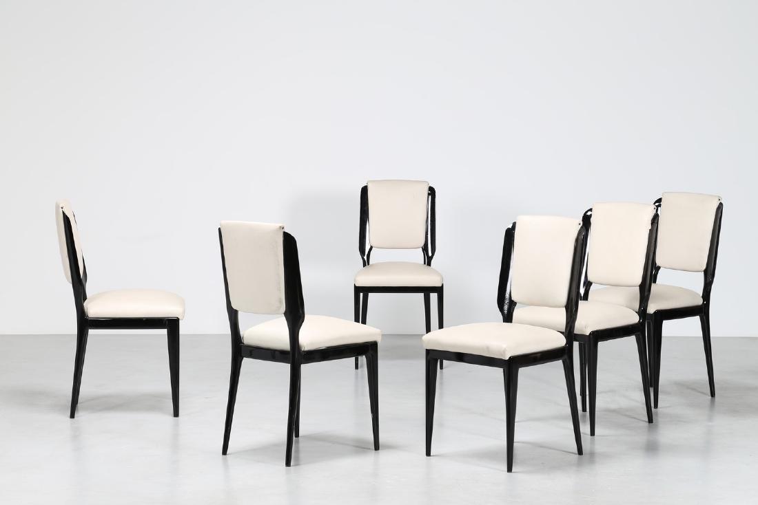 MANIFATTURA ITALIANA  Sei sedie in legno laccato nero e