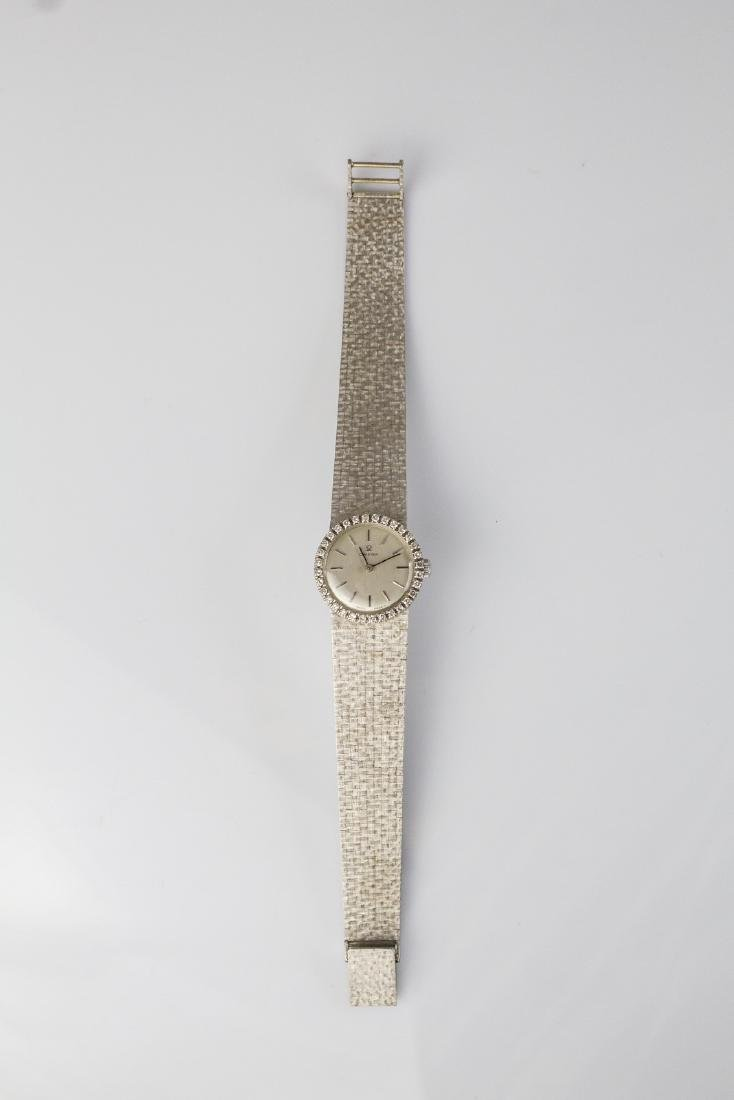 OMEGA  Gold Omega watch with diamonds.
