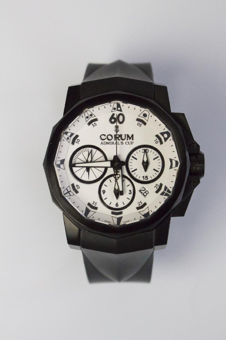 CORUM PVD Steel Corum watch with white heart. Box and