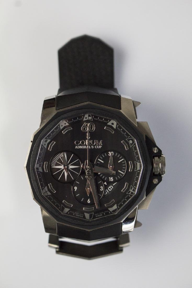 CORUM PVD Steel Corum watch with black heart. Box and