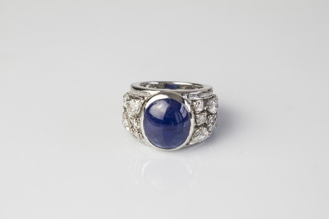 [Nessun Autore] Gold ring with sapphire and diamonds.