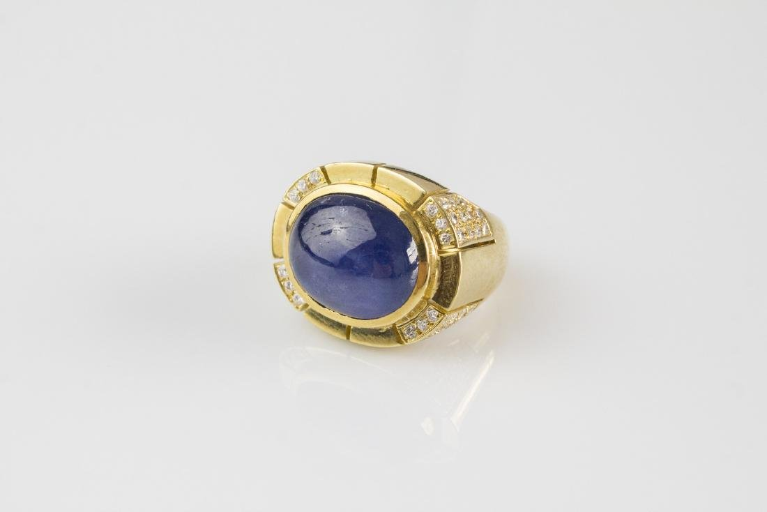 [Nessun Autore] Gold ring with diamonds and sapphire .