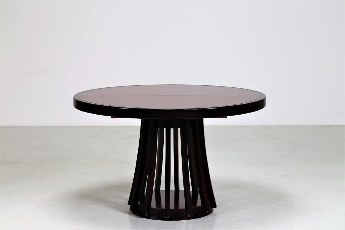 ANGELO MANGIAROTTI Extending table.