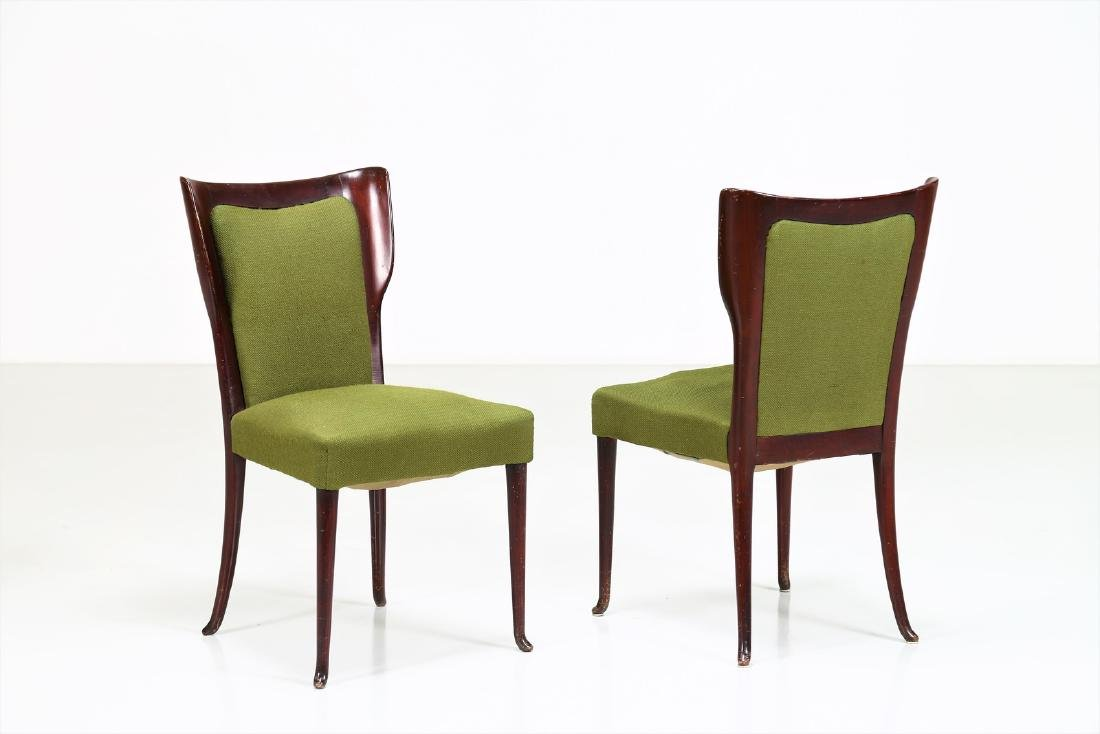 MELCHIORRE BEGA Two wood and fabric chairs by Cassina,