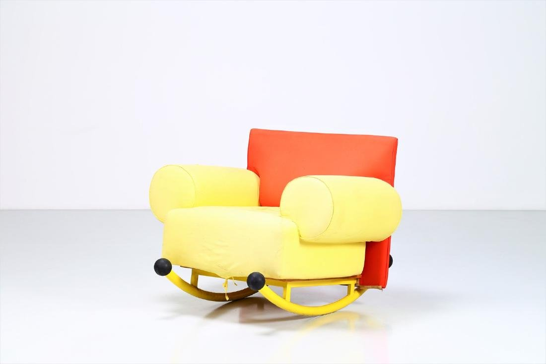 -  Rocking chair in lacquered metal and fabric.