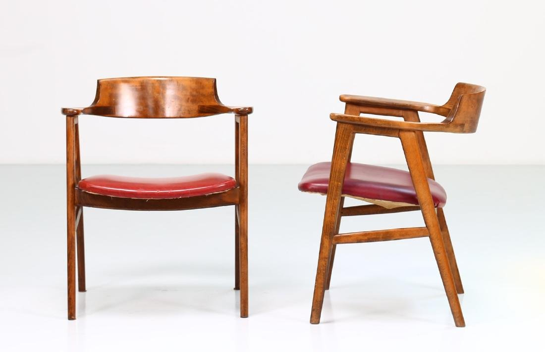 FRATELLI FORNASARIG Pair of chairs in wood and skai, - 2