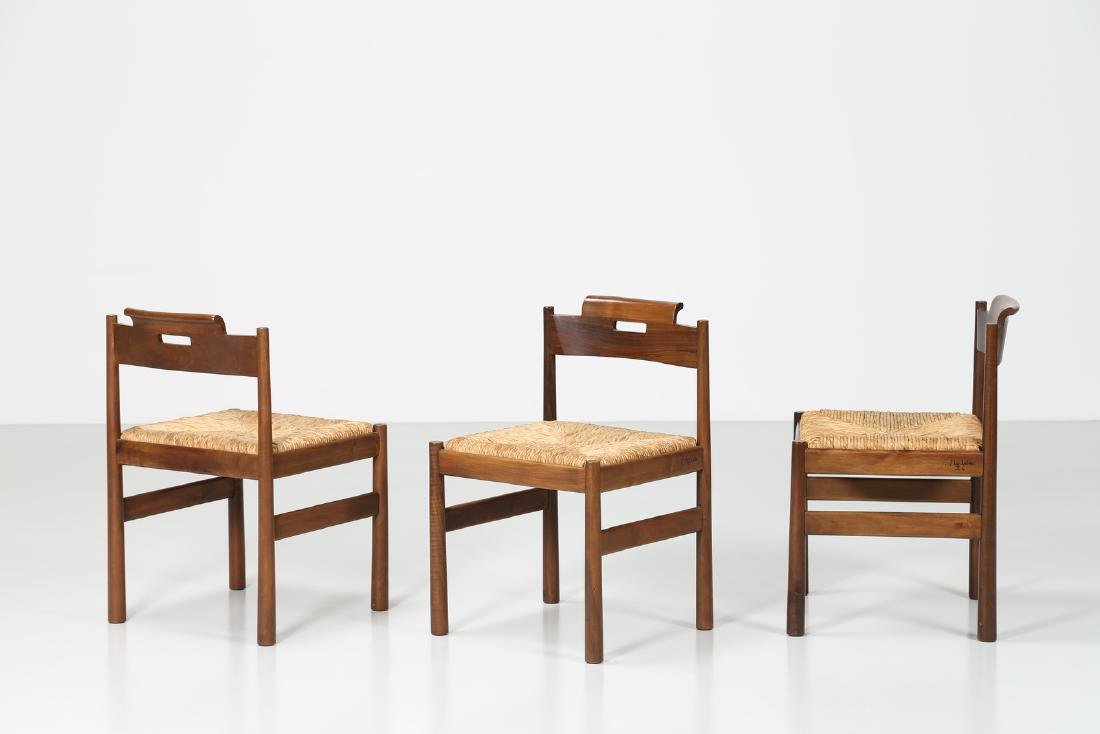 GIOVANNI MICHELUCCI Three walnut and straw chairs, mod.