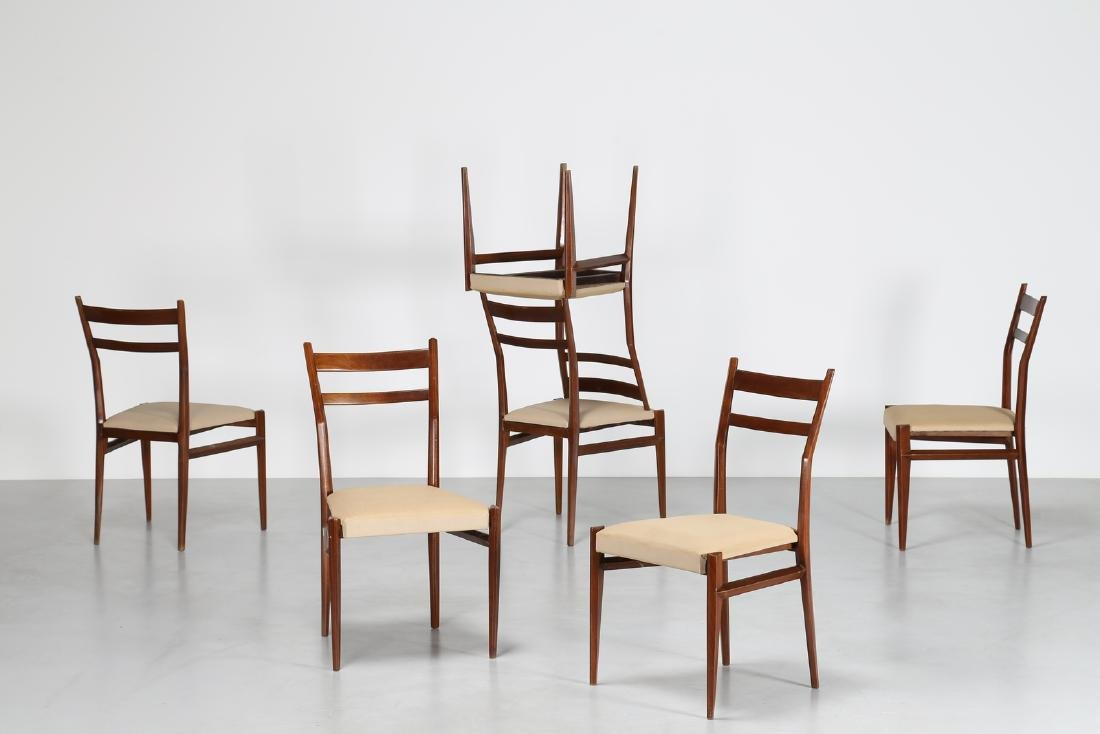 GIULIO MOSCATELLI Six walnut and fabric chairs by