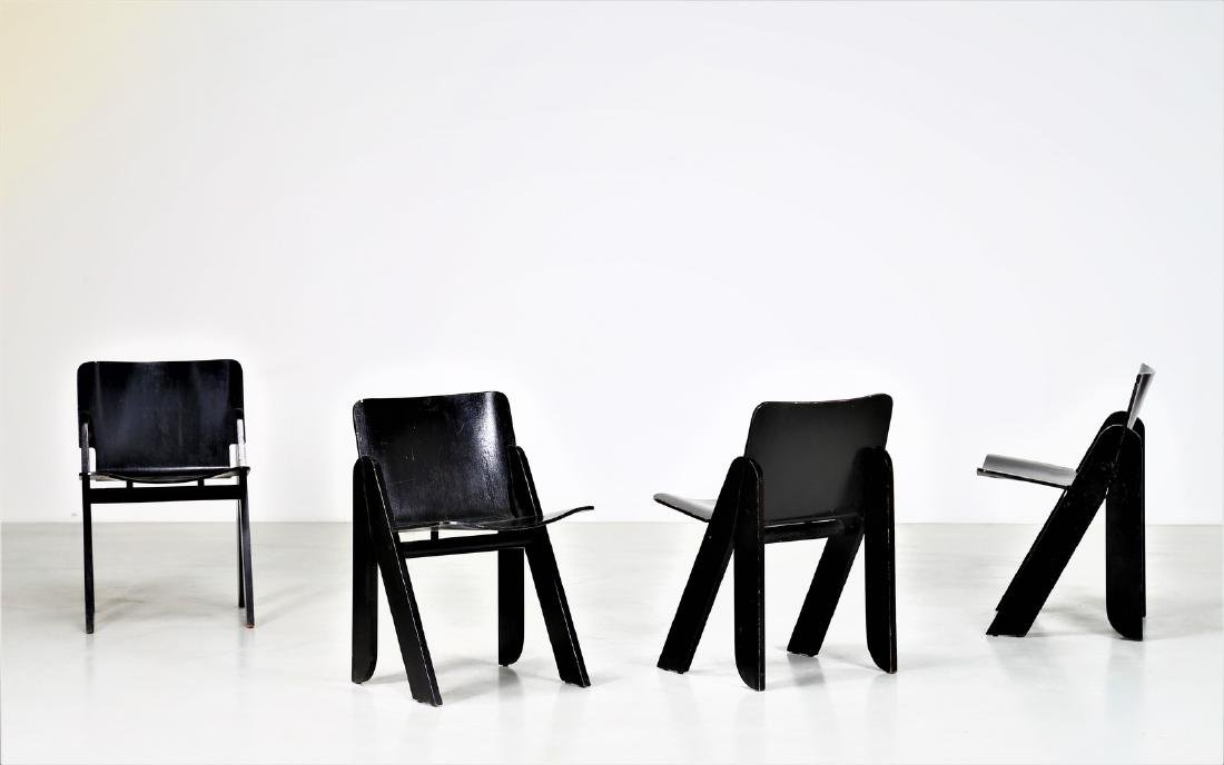 GIGI SABADIN Four chairs in wood and lacquered bent