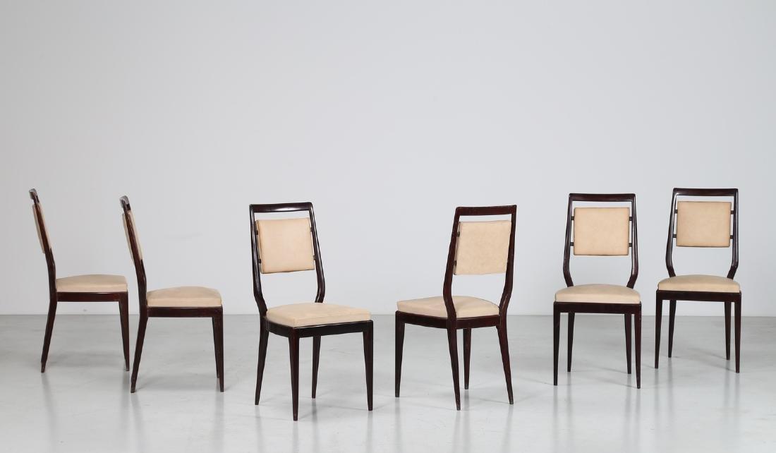 MANIFATTURA ITALIANA  Six mahogany and skai chairs,
