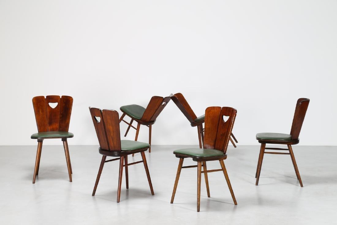 GUGLIELMO PECORINI Six wood and skai chairs, 1950s .