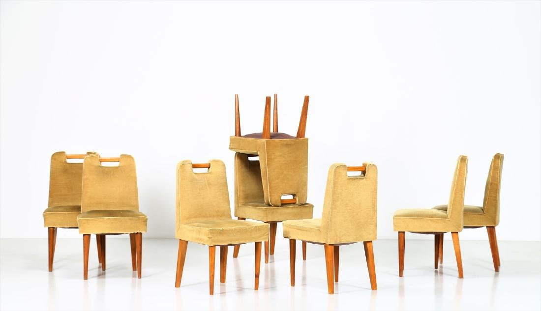 UGO CARA' Eight wood and fabric chairs, 1950s.