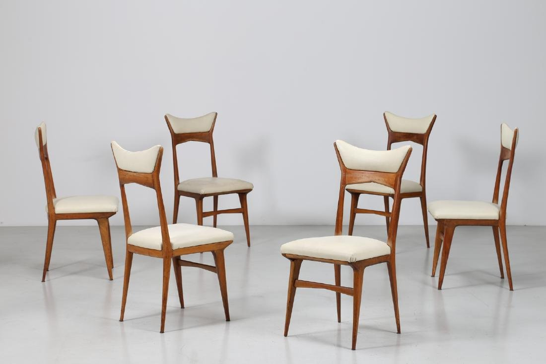 MANIFATTURA ITALIANA  Six wood and skai chairs, 1950s.