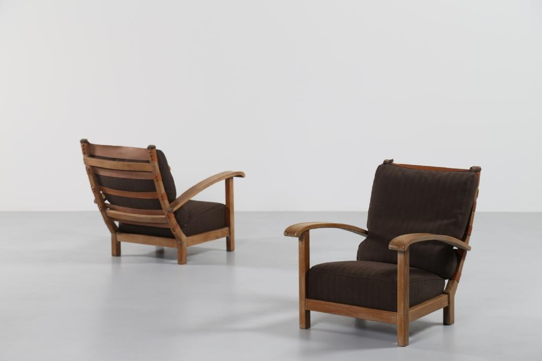 MANIFATTURA ITALIANA  Pair of oak armchairs in oak with