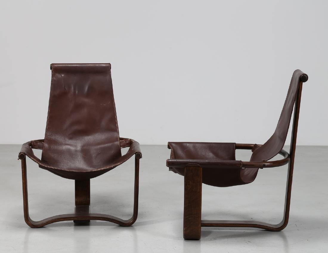 INGMAR RELLING Pair of wood and leather armchairs,