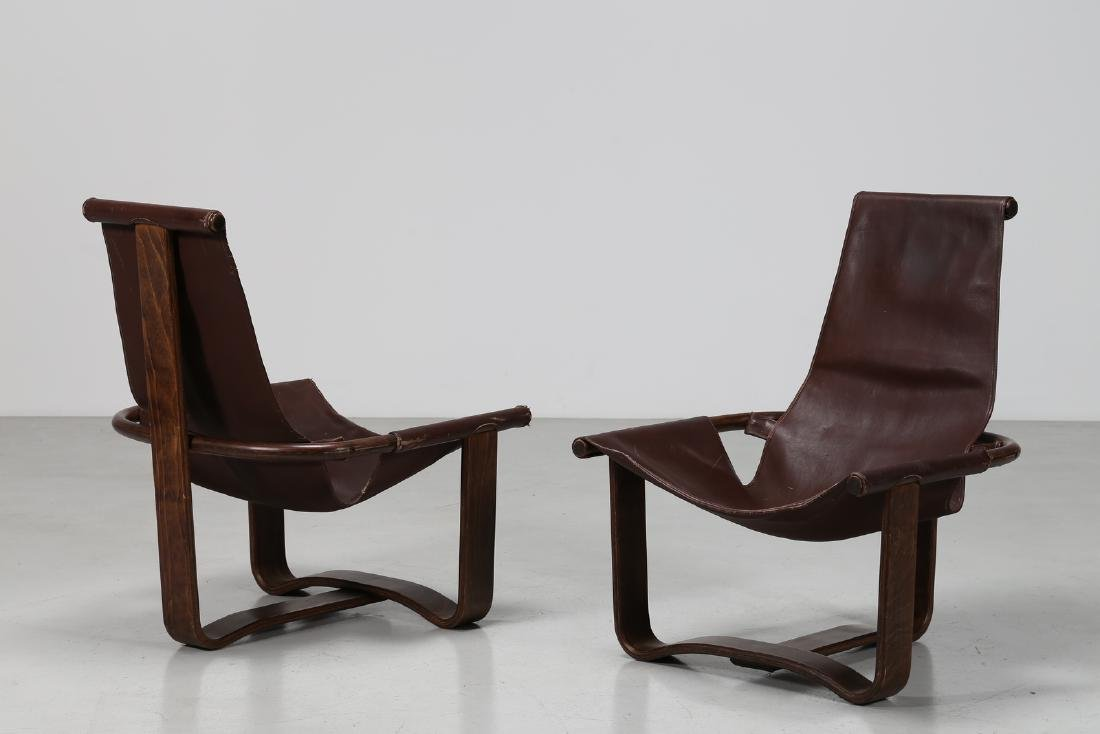 INGMAR RELLING Pair of wood and leather armchairs, - 2