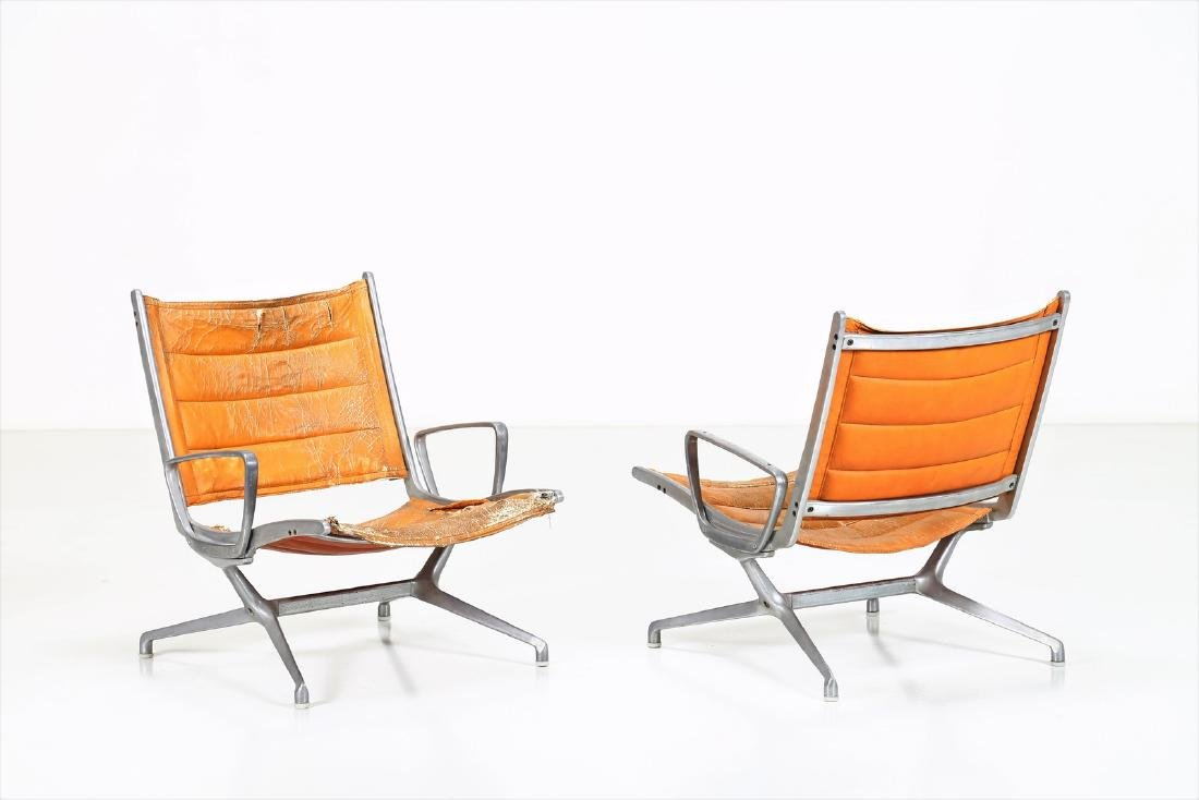 PAUL TUTTLE Pair of aluminium and leather armchairs,