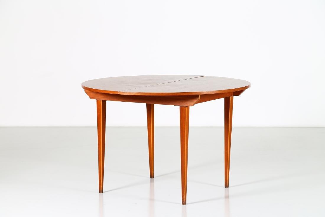 MANIFATTURA ITALIANA  Round extending table. - 2