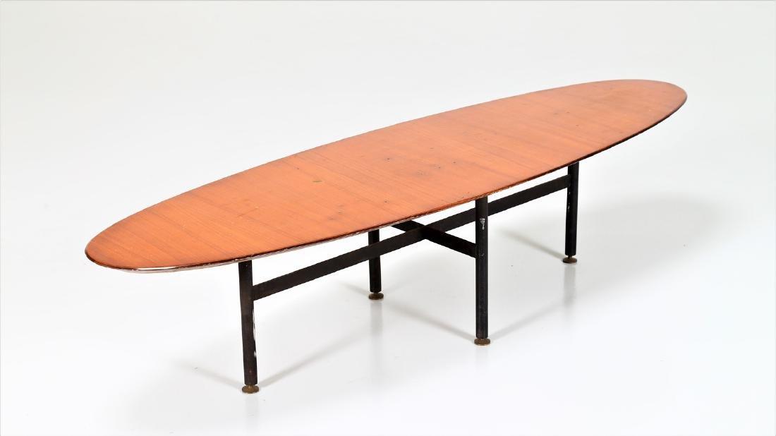 CAMPO & GRAFFI  Distinctive oval coffee table in teak,