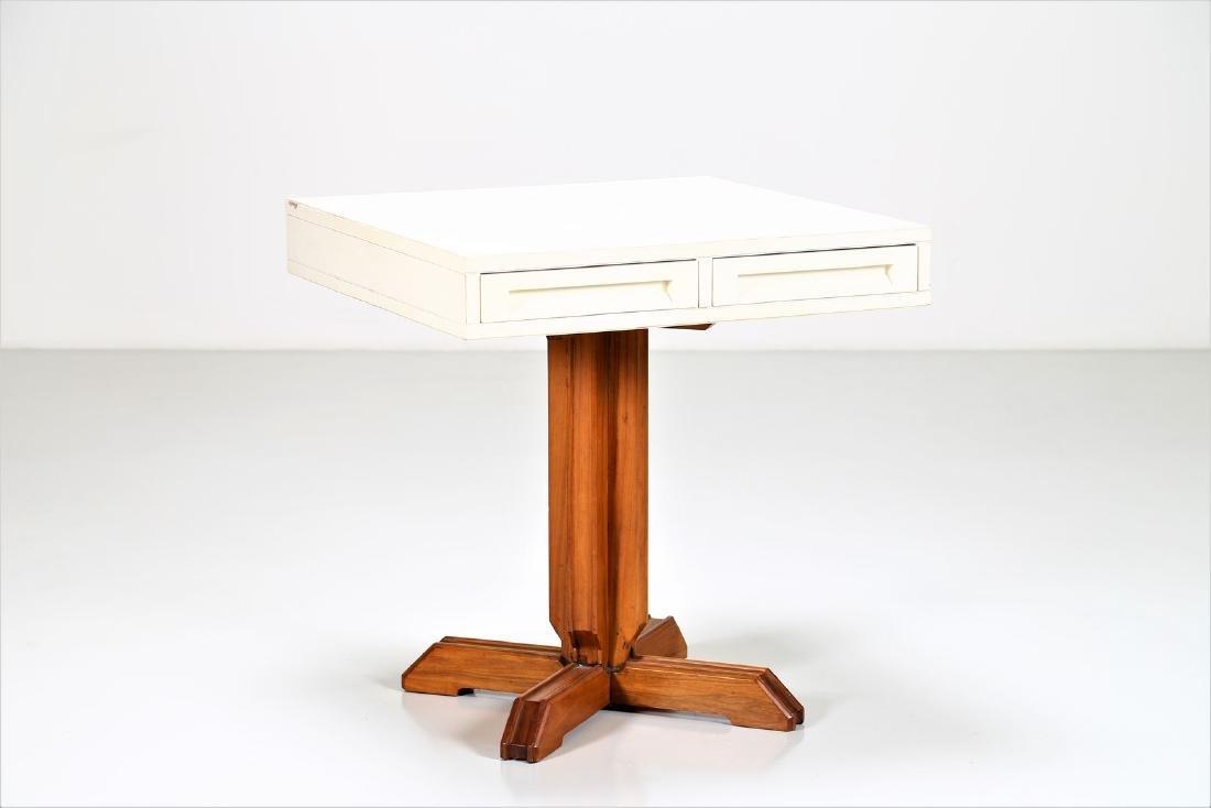 NESTORIO SACCHI Lacquered wood table, 1950s.