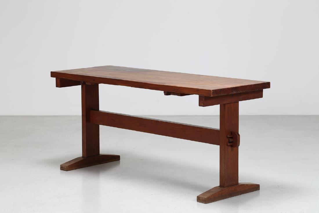GIOVANNI MICHELUCCI Distinctive chestnut table, 1950s.