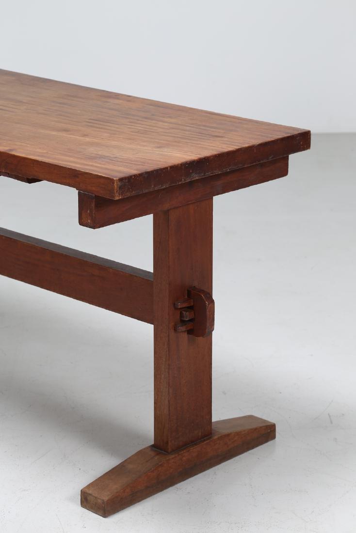 GIOVANNI MICHELUCCI Distinctive chestnut table, 1950s. - 2
