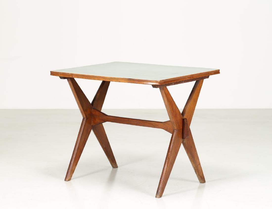 MANIFATTURA ITALIANA  Walnut and Formica table, 1950s.