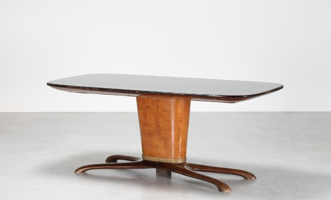 SAVERIO JANNACE  Mahogany table with brass trim and