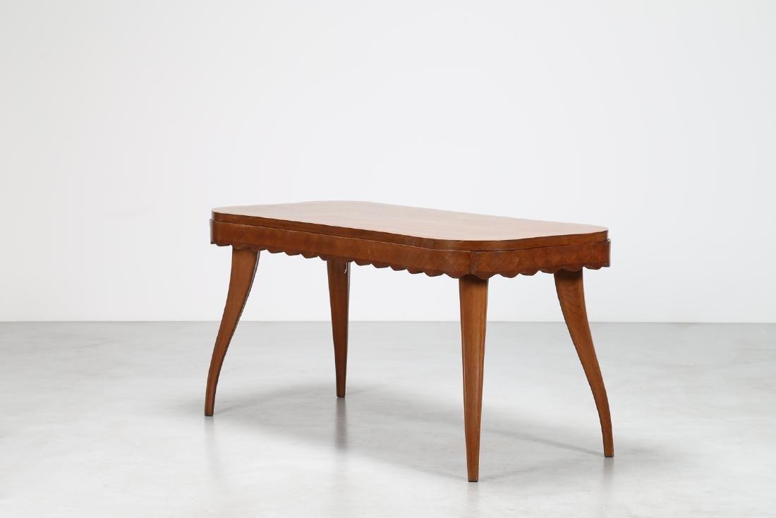 PAOLO BUFFA Extending oak table, 1950s.
