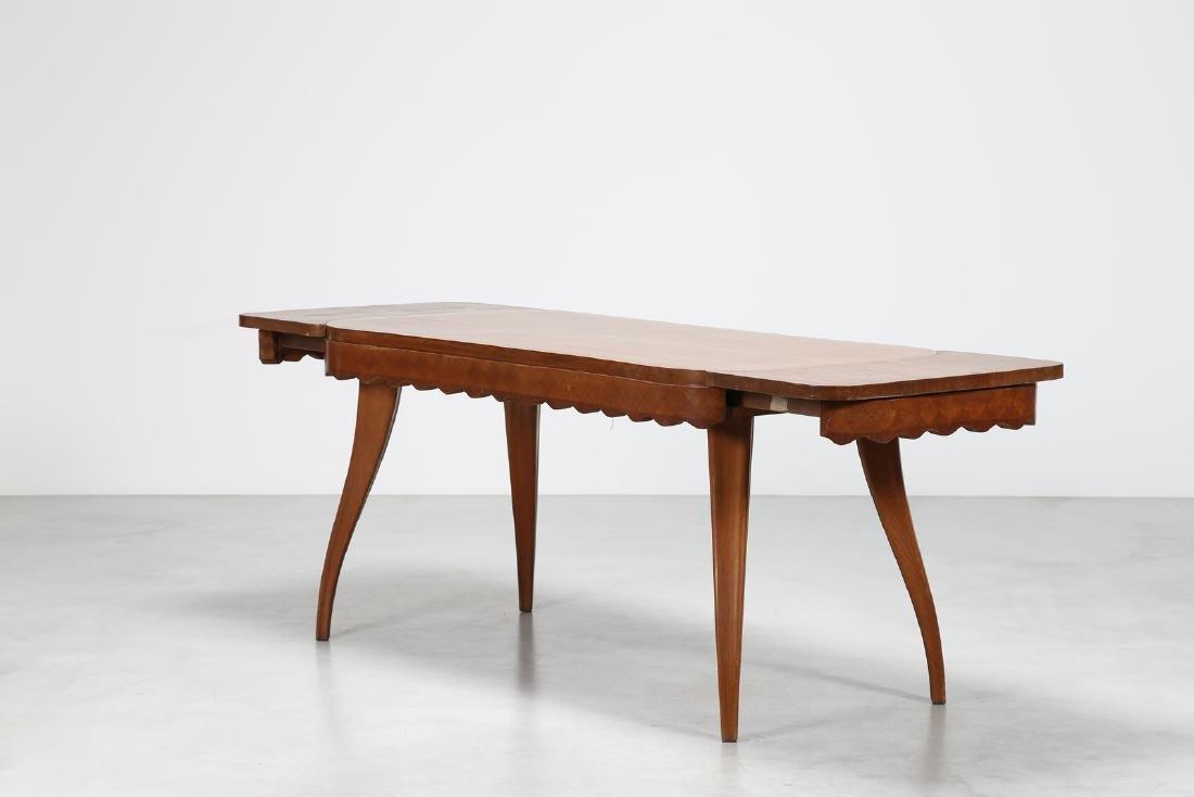 PAOLO BUFFA Extending oak table, 1950s. - 2