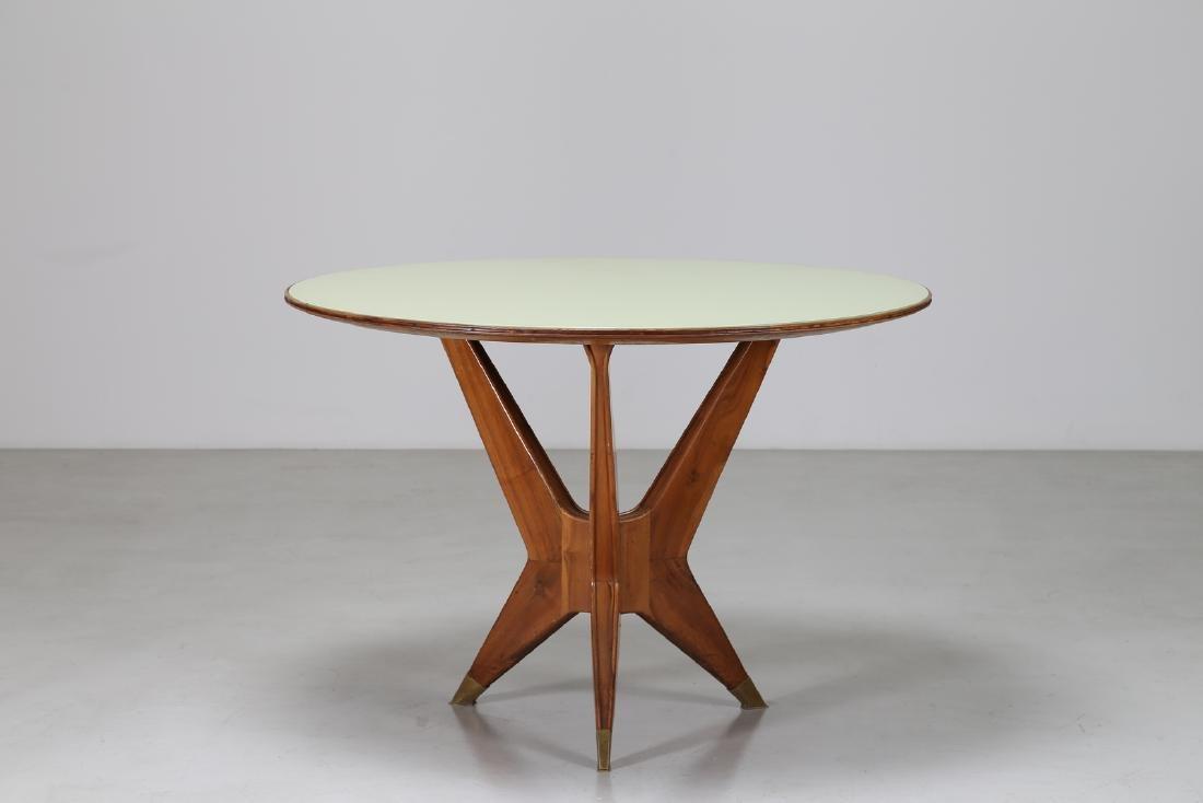 MANIFATTURA ITALIANA  Round table in walnut, brass and