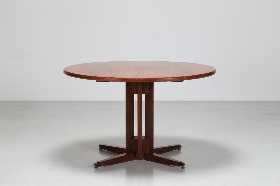 GUGLIELMO ULRICH Round teak table with brass feet,
