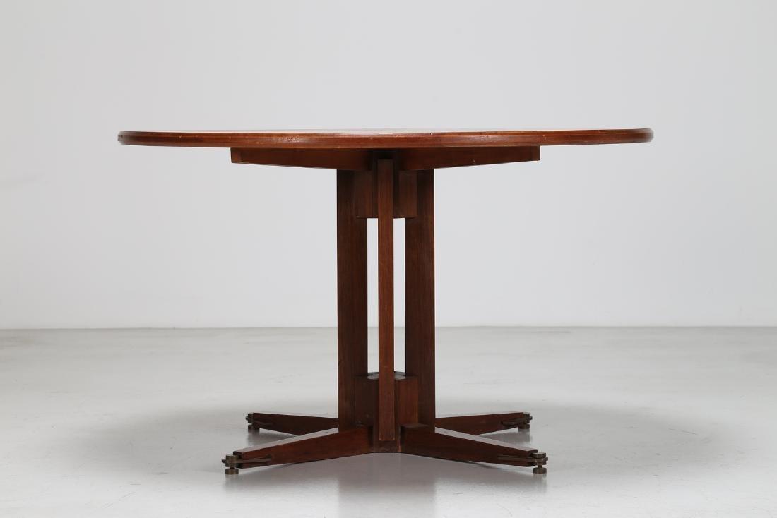 GUGLIELMO ULRICH Round teak table with brass feet, - 2
