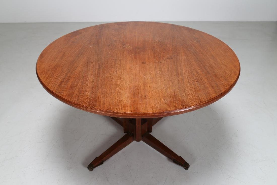 GUGLIELMO ULRICH Round teak table with brass feet, - 4