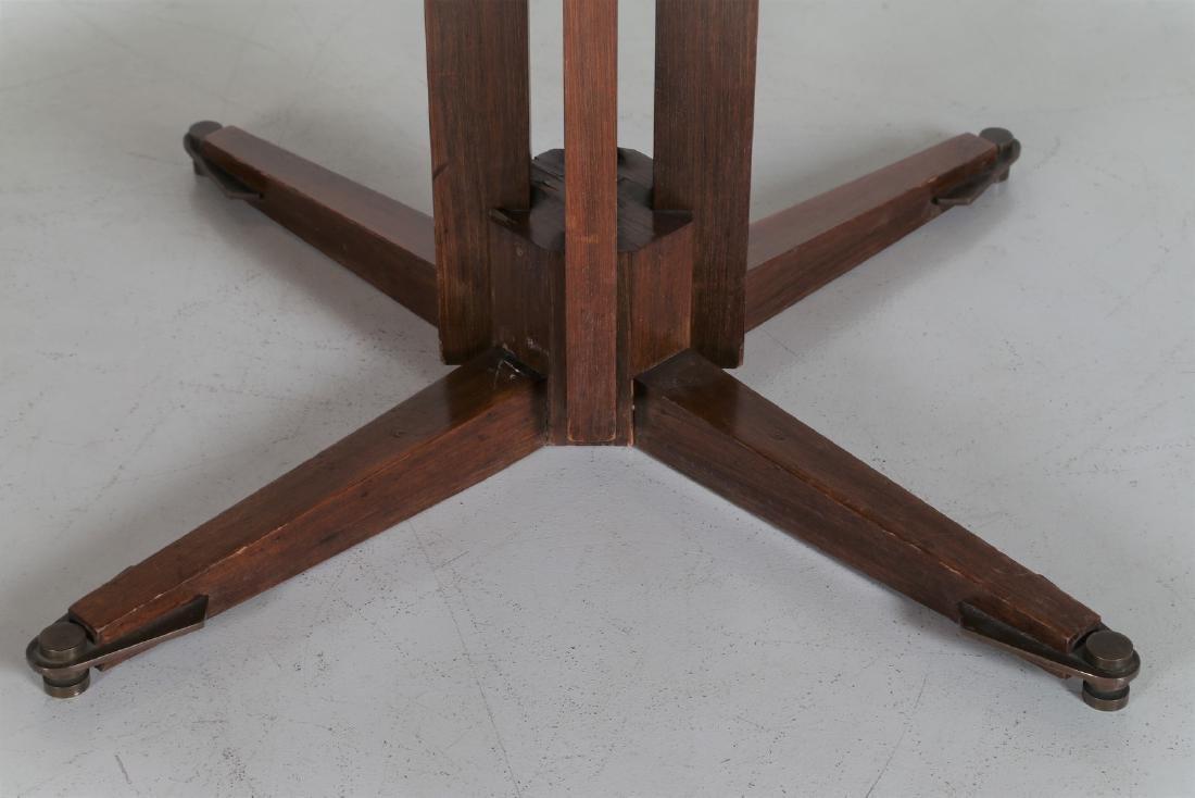 GUGLIELMO ULRICH Round teak table with brass feet, - 5