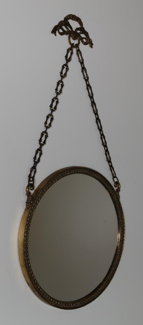 MANIFATTURA ITALIANA  Bronze and glass wall mirror,