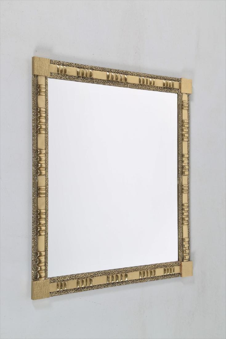 FRIGERIO DI DESIO  Wall mirror in brass and glass,