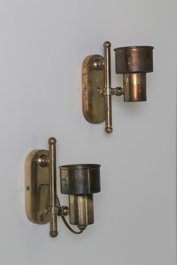 MANIFATTURA ITALIANA  Pair of brass wall lamps, 1950s.