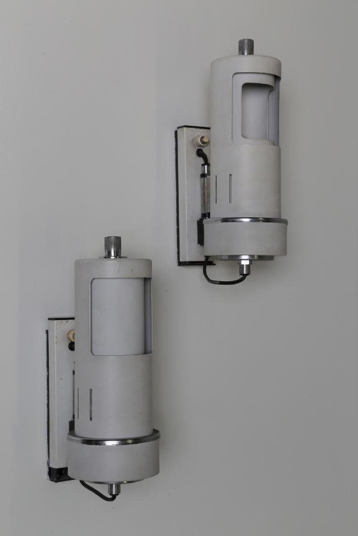 MANIFATTURA ITALIANA  Pair of wall lamps in lacquered,
