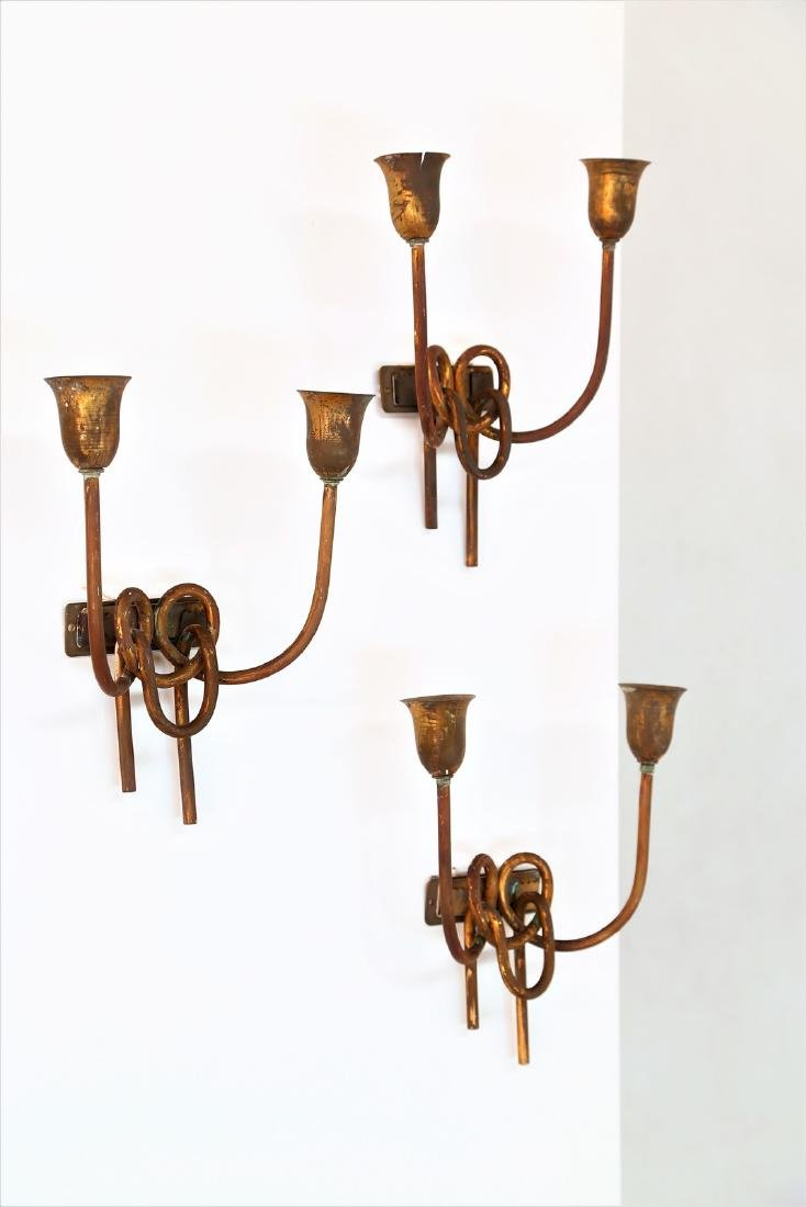 LUMI MILANO  Three brass wall lamps 1940s/50s.