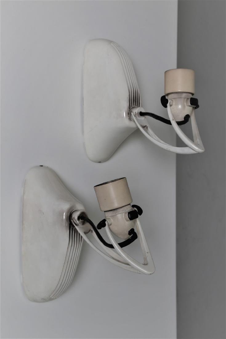 FASE Distinctive pair of wall lamps in lacquered metal,