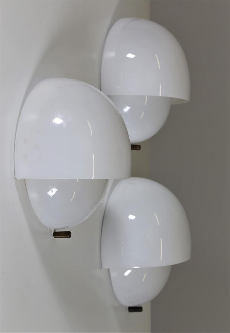 VICO MAGISTRETTI Three wall lamps in opal glass,