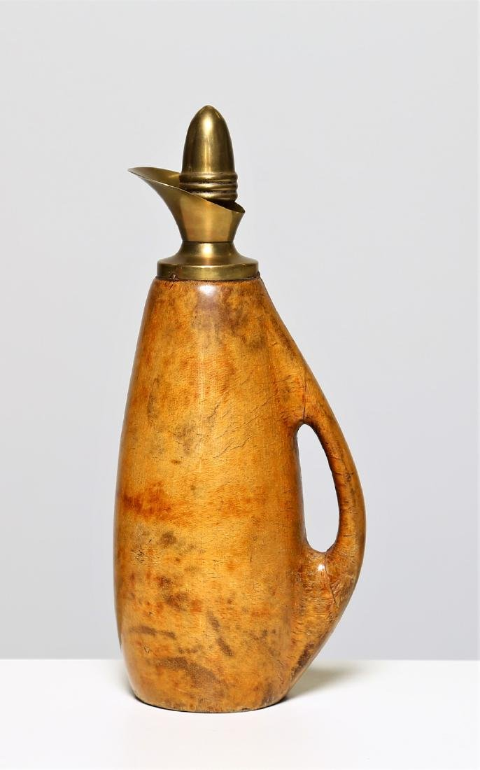 ALDO TURA Carillon flask in brass and parchment, in