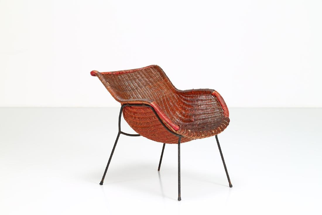 -  Metal and wicker armchair, 1950s.