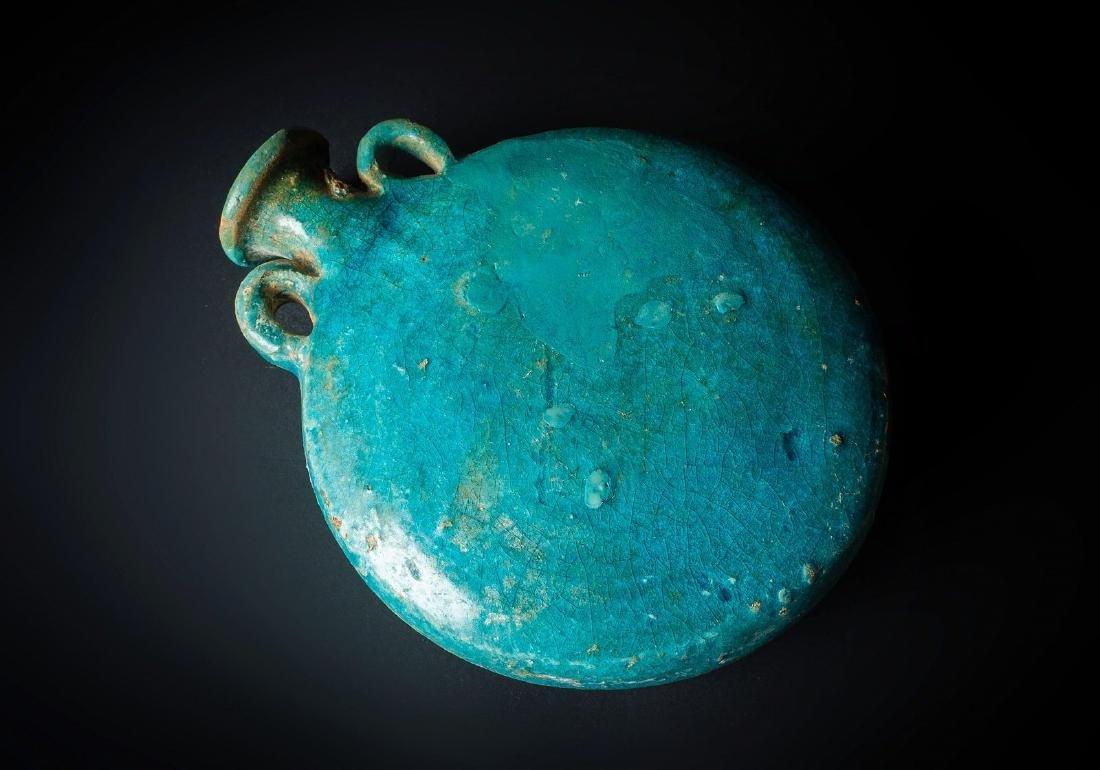 Arte Islamica  An unusual shaped turquoise glazed