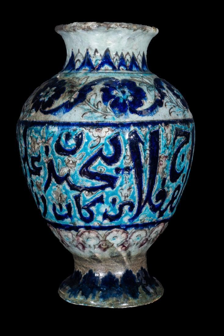Arte Islamica  A turquoise and lustre pottery vase with