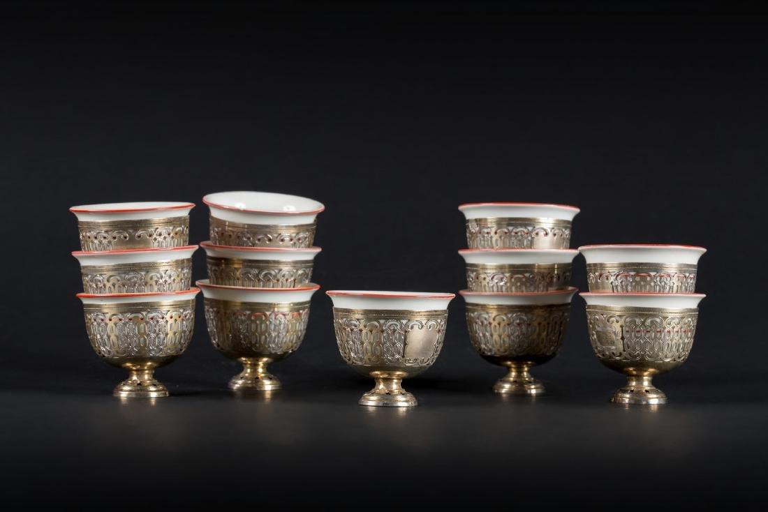 Arte Islamica  Twelve zarfs in European porcelain and - 2