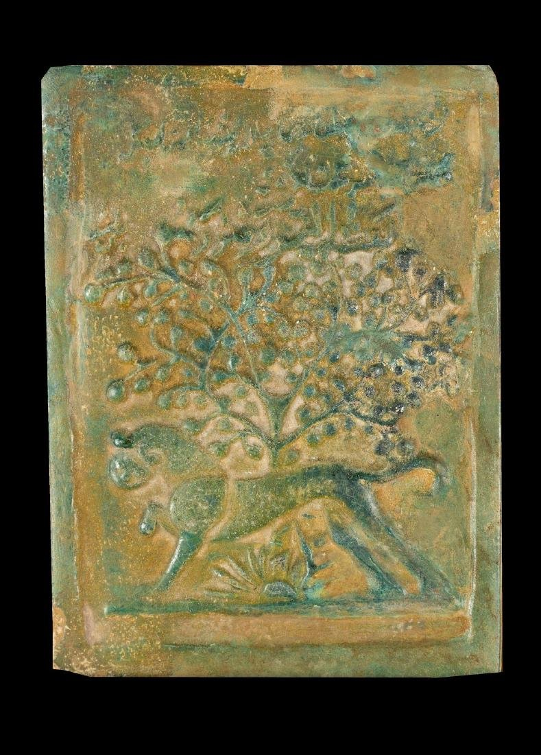 Arte Islamica  A pottery tile decorated with lion, tree